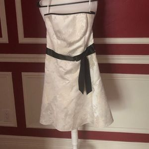 Cream with black accents cocktail dress